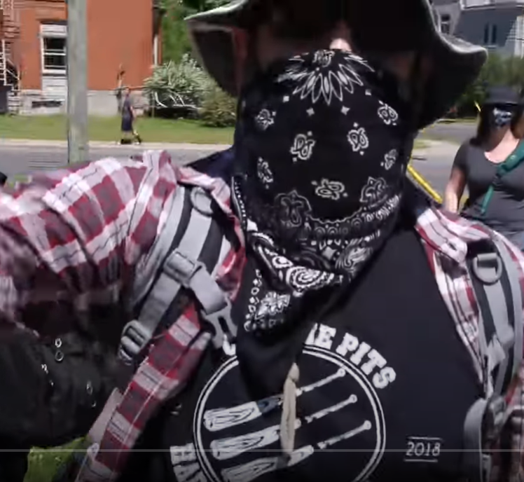 Kingston police have charged this man after he allegedly shoved a media personality at a protest on June 20.