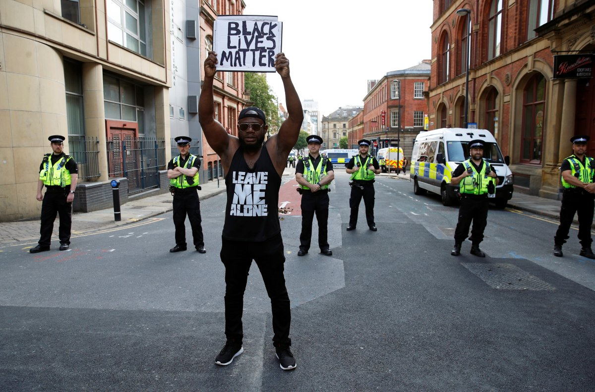 A demonstrator holds up a placard during a Black Lives Matter protest following the death of George Floyd in Minneapolis police custody, in Leeds, Britain June 14, 2020.