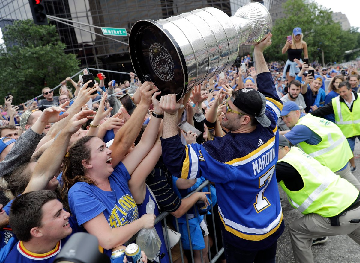 St. Louis Blues left wing Pat Maroon (7) celebrates with fans during the Blues' NHL hockey Stanley Cup victory parade in St. Louis on Saturday, June 15, 2019.