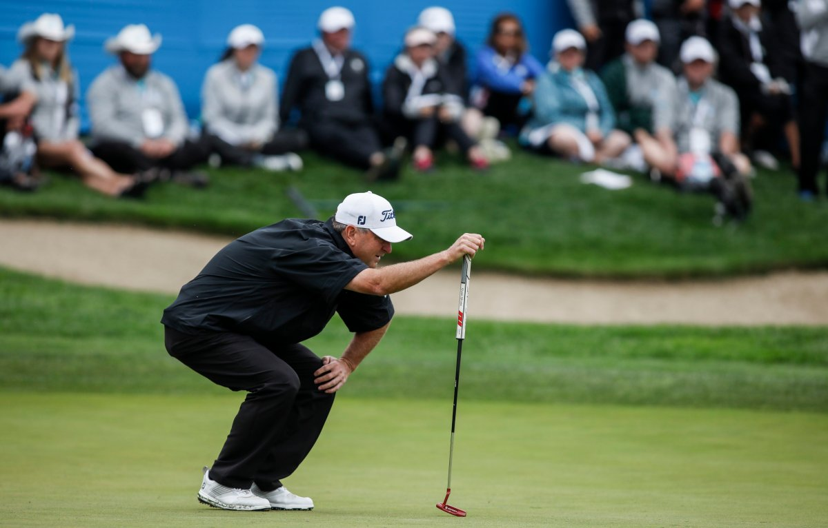 Wes Short Jr., of Austin, TX, lines up his putt on the 18th green during the PGA Tour Champion's Shaw Charity Classic golf event in Calgary, Sunday, Sept. 1, 2019.