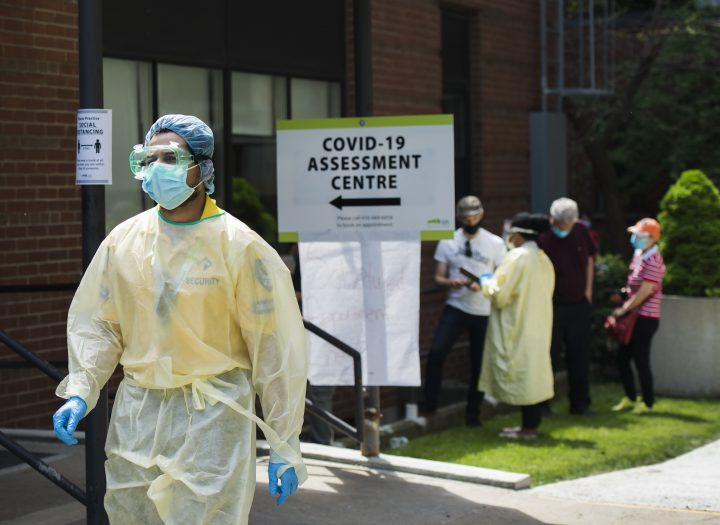 People line up to be tested at a COVID-19 assessment centre in Toronto on Tuesday, May 26, 2020.
