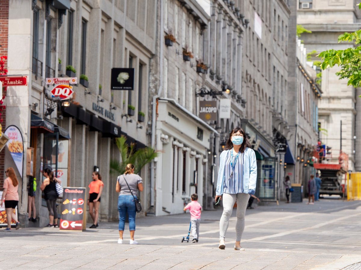 People walk past closed restaurants and bars in Old Montreal Thursday, June 4, 2020 in Montreal.