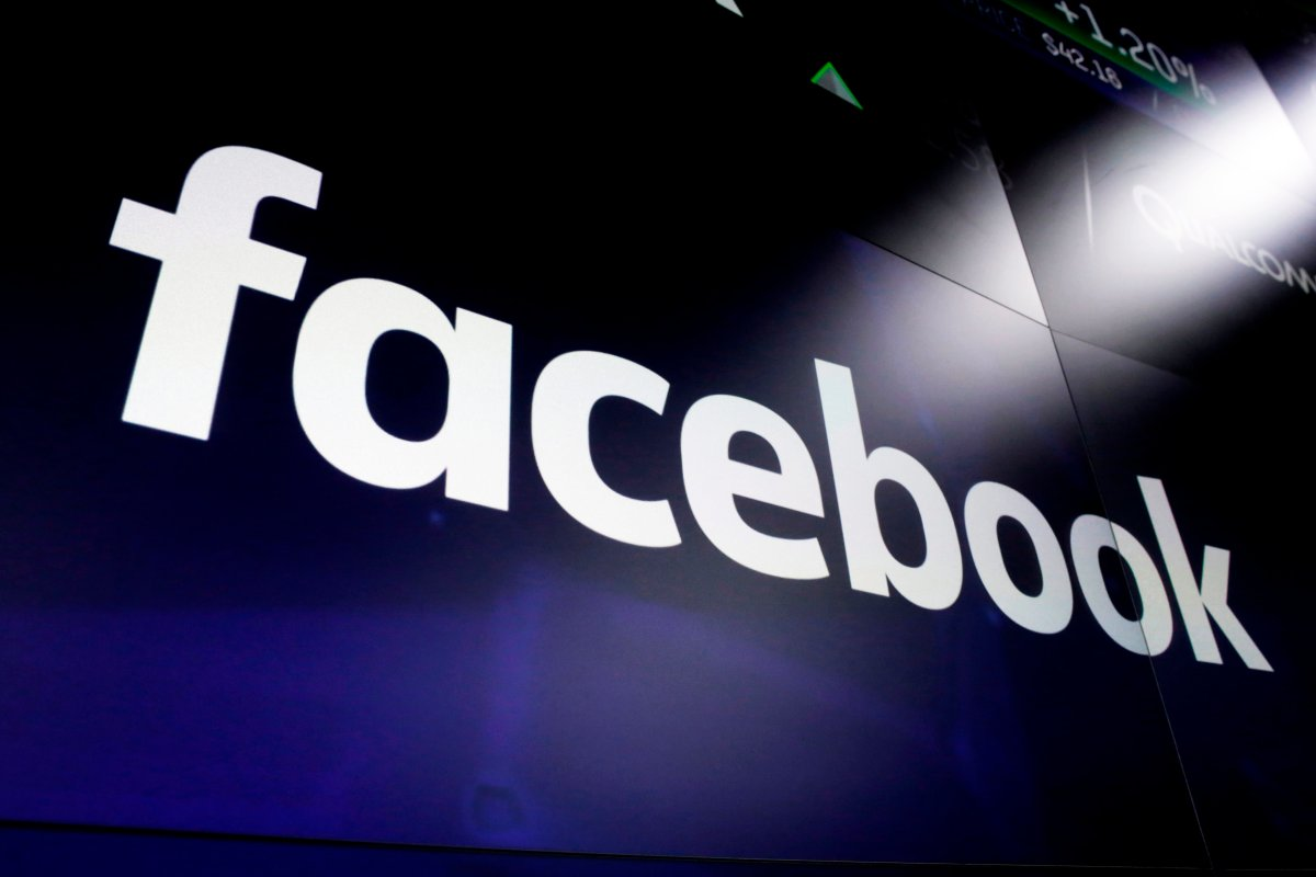 FILE - This March 29, 2018, file photo shows the Facebook logo on screens at the Nasdaq MarketSite in New York's Times Square.