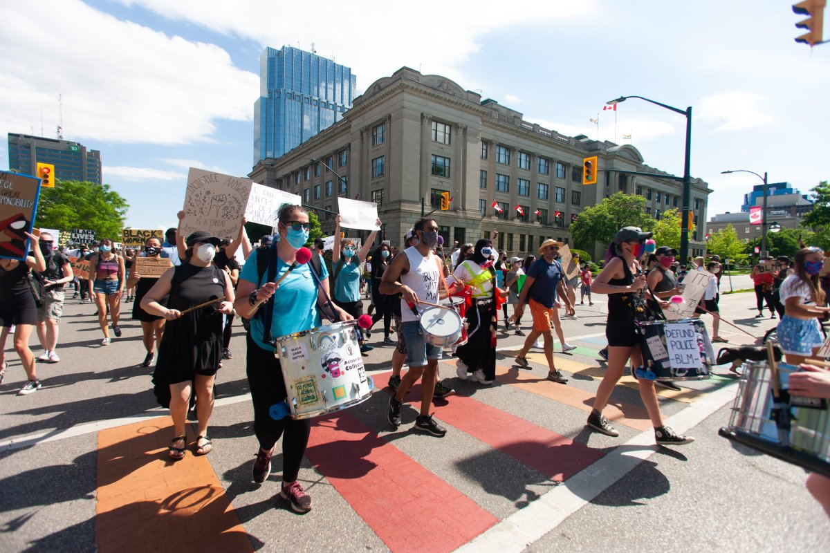 Demonstrators march down Wellington Street in downtown London, Ont. as part of a Black Lives Matter rally to protest racism, systemic discrimination, and police brutality, June 6, 2020.