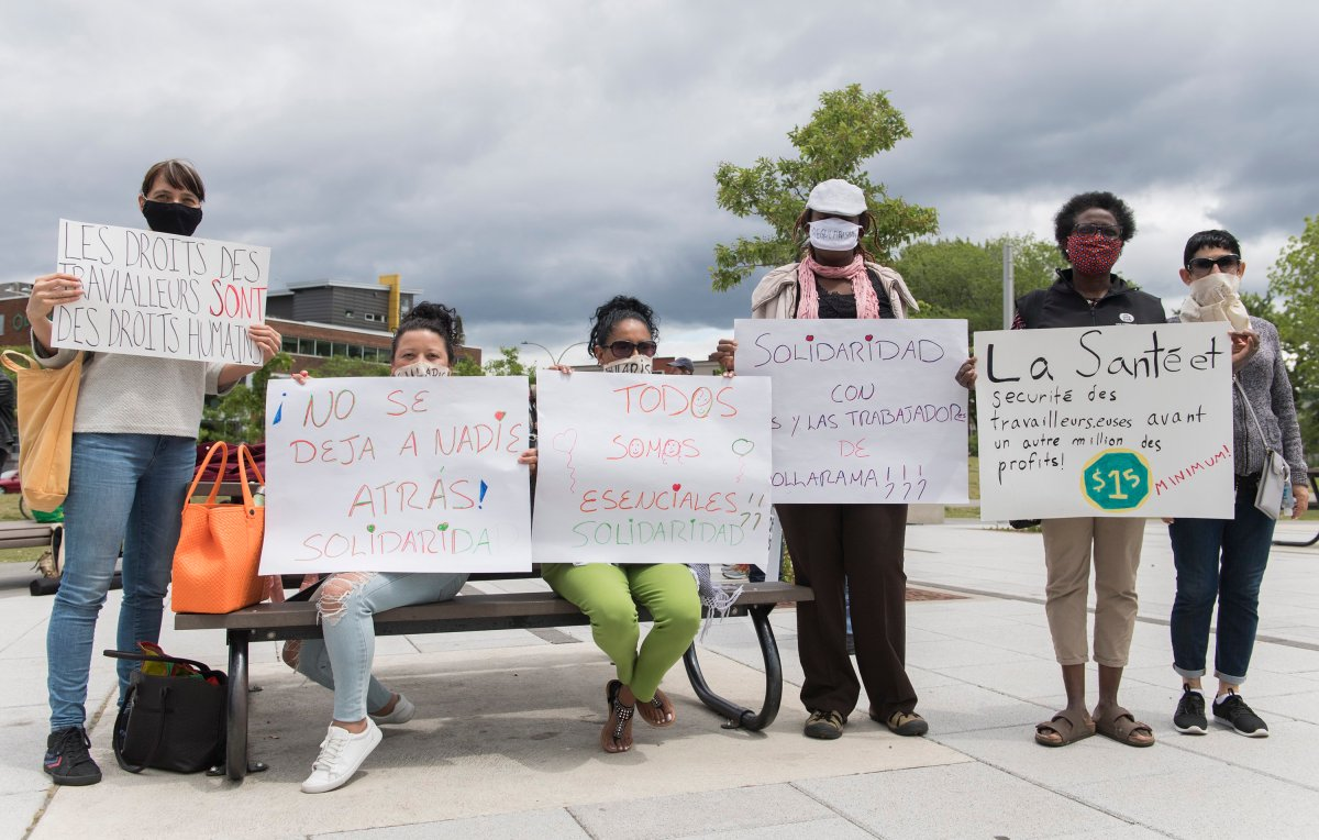Dollarama workers hold up signs during a protest calling for better pay and working conditions in Montreal, Saturday, June 13, 2020, as the COVID-19 pandemic continues in Canada and around the world.