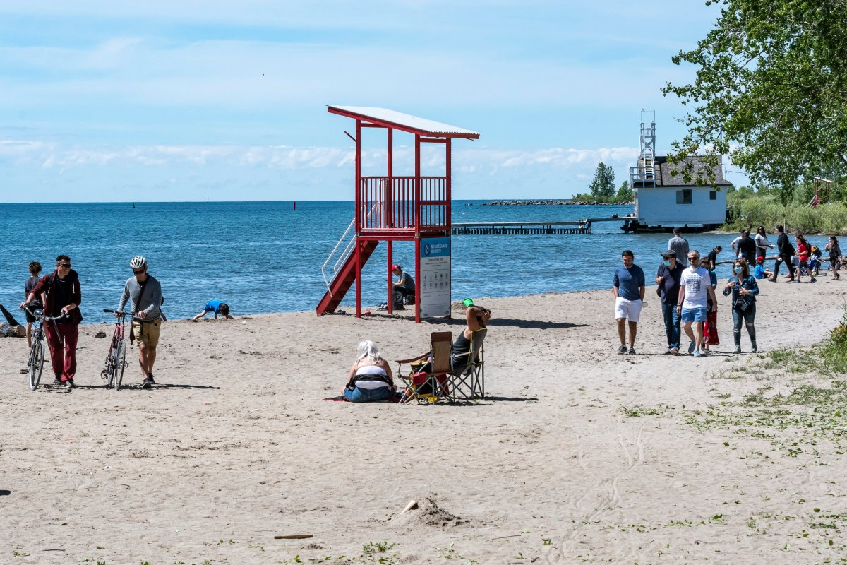 General view of people enjoying the nice weather at Cherry Beach while observing social distancing in downtown Toronto on June 14, 2020.