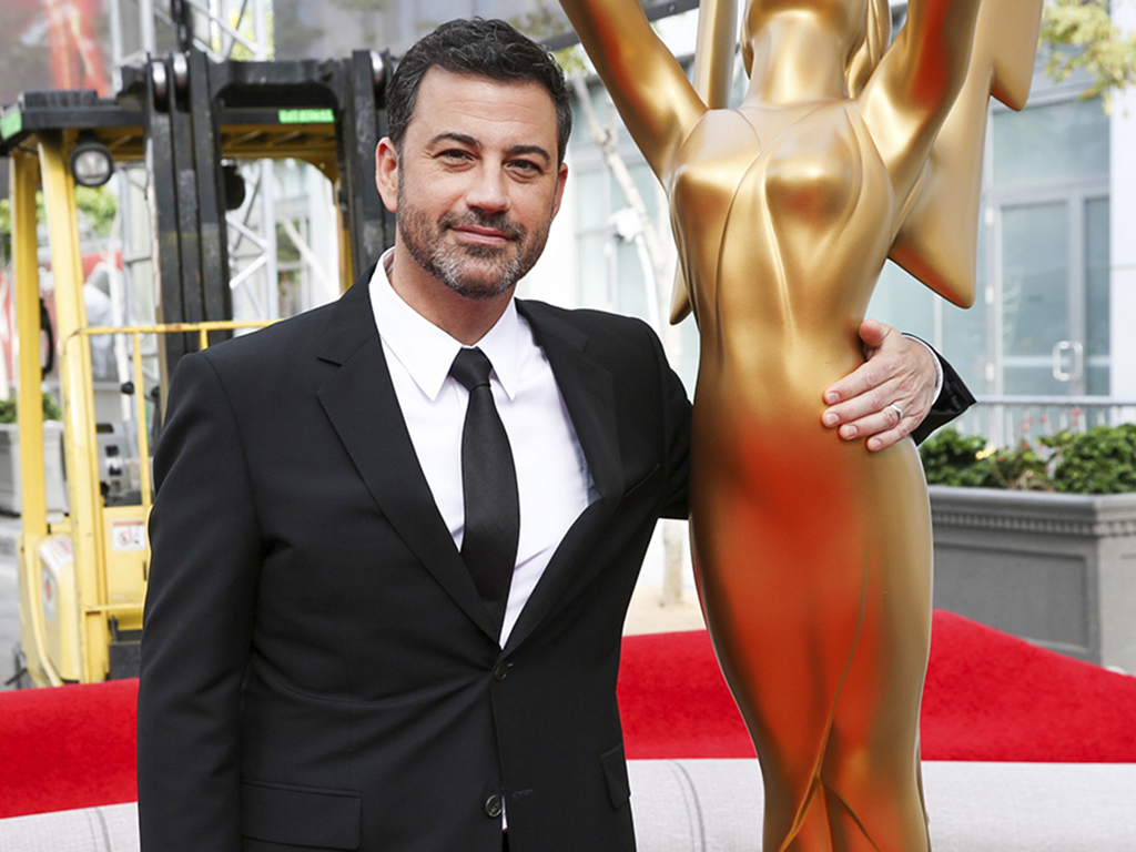 This Sept. 14, 2016 file photo shows host Jimmy Kimmel posing for a photo with a replica of an Emmy statue at the Primetime Emmy Awards Press Preview Day in Los Angeles, Calif.