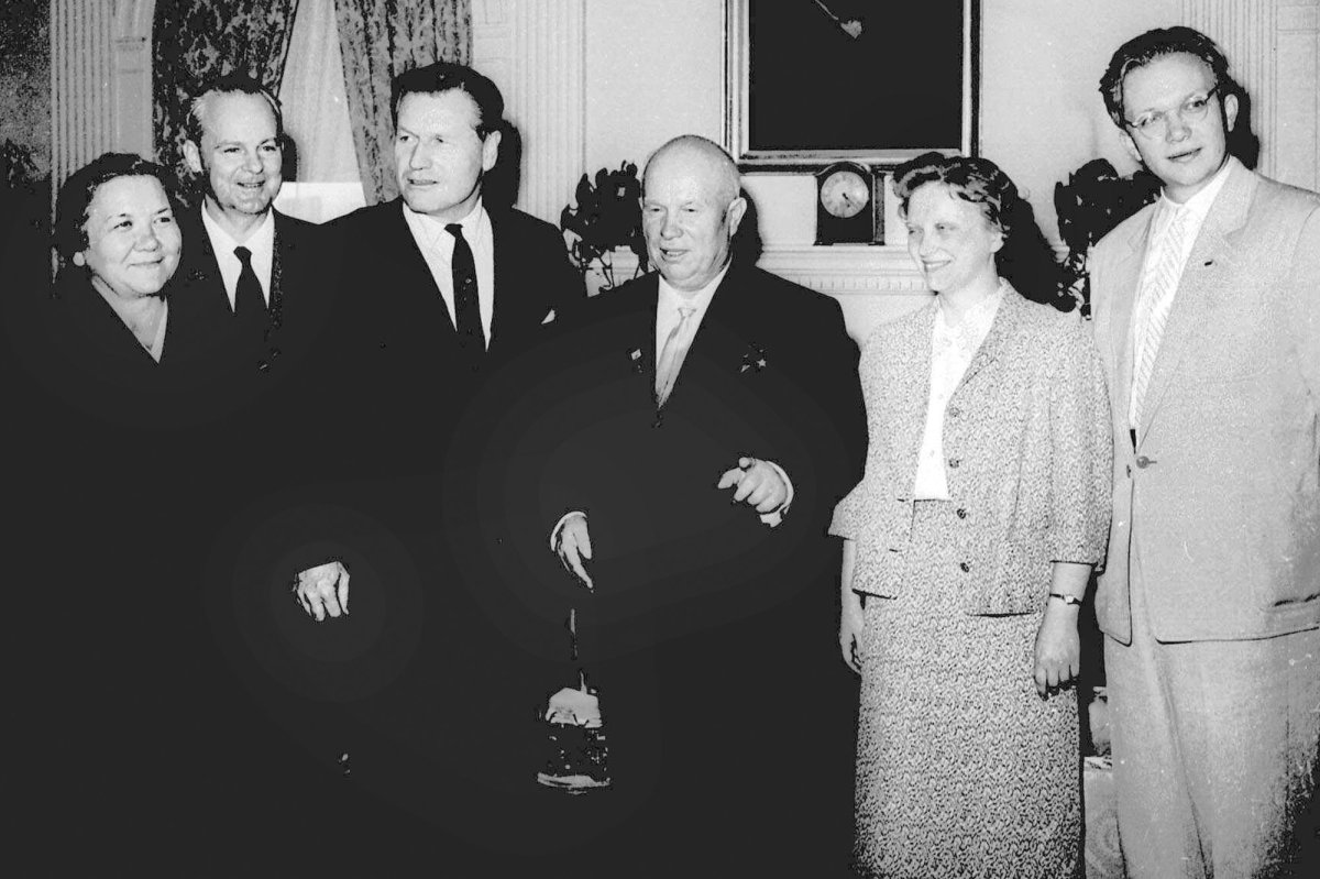 FILE - In this Sept. 18, 1959, file photo, then-New York Gov. Nelson Rockefeller, third from left, and Soviet Premier Nikita Khrushchev, fourth from left, pose during the governor's visit to the premier's suite in New York's Waldorf-Astoria. From left, are: the premier's wife, Nina, Soviet Ambassador to the U.S. Mikhail Menshikov, Gov. Rockefeller, Rada Adzhubel, the premier's daughter, and Sergei Khrushchev, far right, the premier's son. Sergei Khrushchev died Thursday, June 18, 2020, at his home in Cranston, Rhode Island. He was 84.