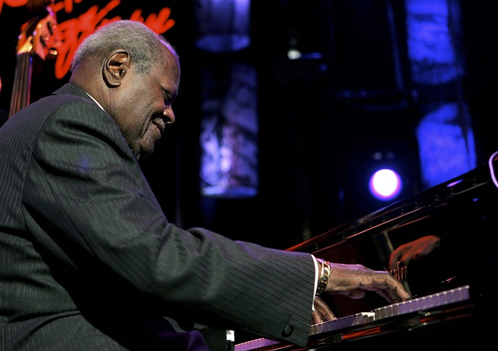 In this July 2005 file photo, Canadian jazz legend Oscar Peterson performs on the Stravinski hall stage during the 39th Montreux Jazz Festival in Montreux, Switzerland.
