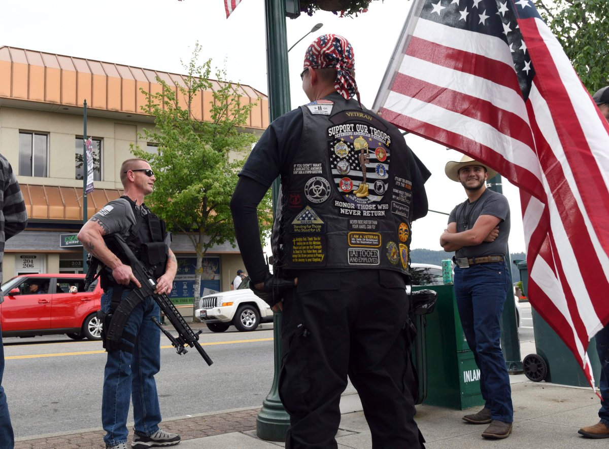 Armed men stand nearby during a Black Lives Matter protest in Coeur d'Alene, Idaho, on June 2, 2020.