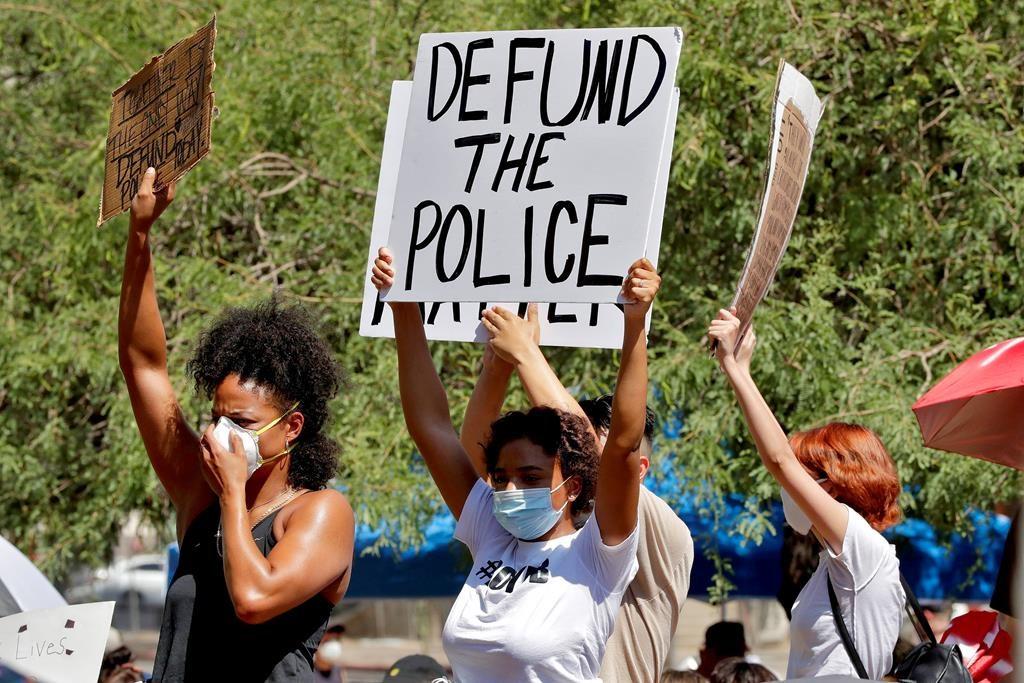 Protesters rally Wednesday, June 3, 2020, in Phoenix, Ariz., demanding the Phoenix city council defund the Phoenix Police Department.