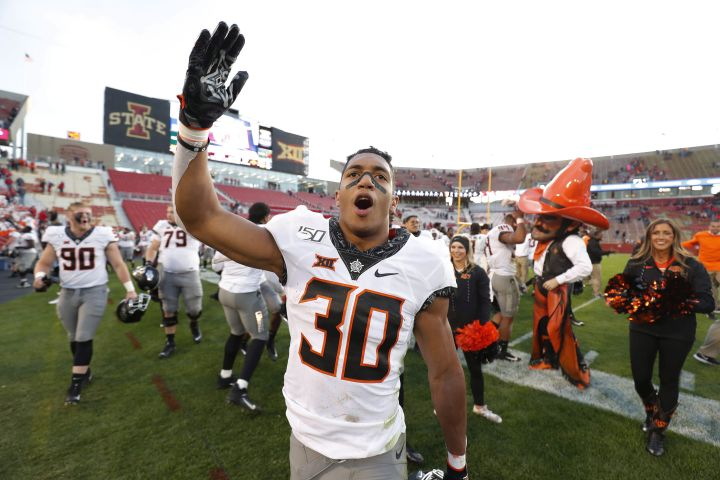 Oklahoma State running back Chuba Hubbard blows a kiss to the Oklahoma State fans after their 34-27 win over Iowa State after an NCAA college football game, Saturday, Oct. 26, 2019, in Ames, Iowa.