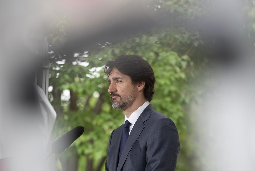 Prime Minister Justin Trudeau responds to a question during a news conference outside Rideau Cottage in Ottawa, Thursday, June 25, 2020, about the same time the Privy Council Office was polling Canadians about the government's response to the coronavirus.