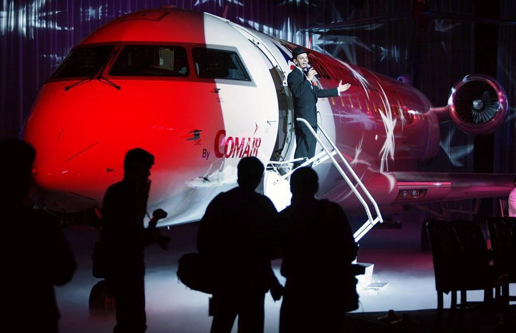 An entertainer sings from the steps of the 1,000th Bombardier Aerospace CRJ regional jet delivered during a ceremony in Montreal, Tuesday, Dec. 9, 2003.