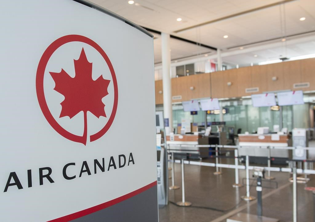 An Air Canada check-in area is shown at Montreal-Pierre Elliott Trudeau International Airport, Saturday, May 16, 2020.