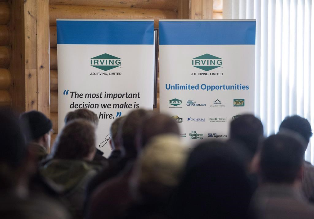 J.D. Irving Ltd. signage is seen as hundreds of people attend a job fair in Sussex, N.B., on Thursday, January 28, 2016.