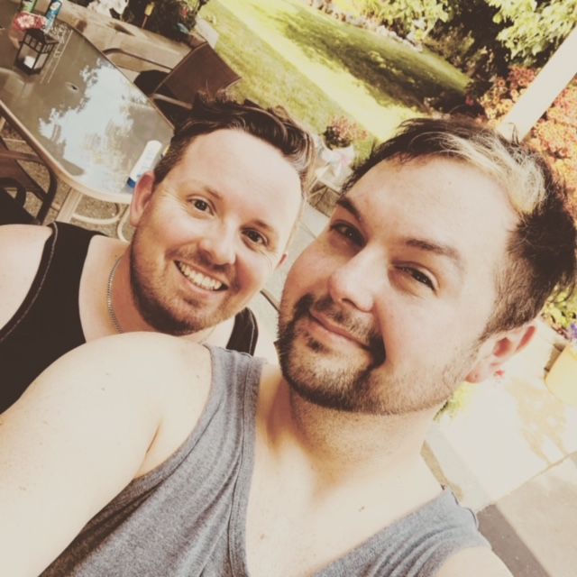 Winnipegger Jeremy Ernst (left) and his partner Michael Laducer are separated by the Canadian-U.S. border.