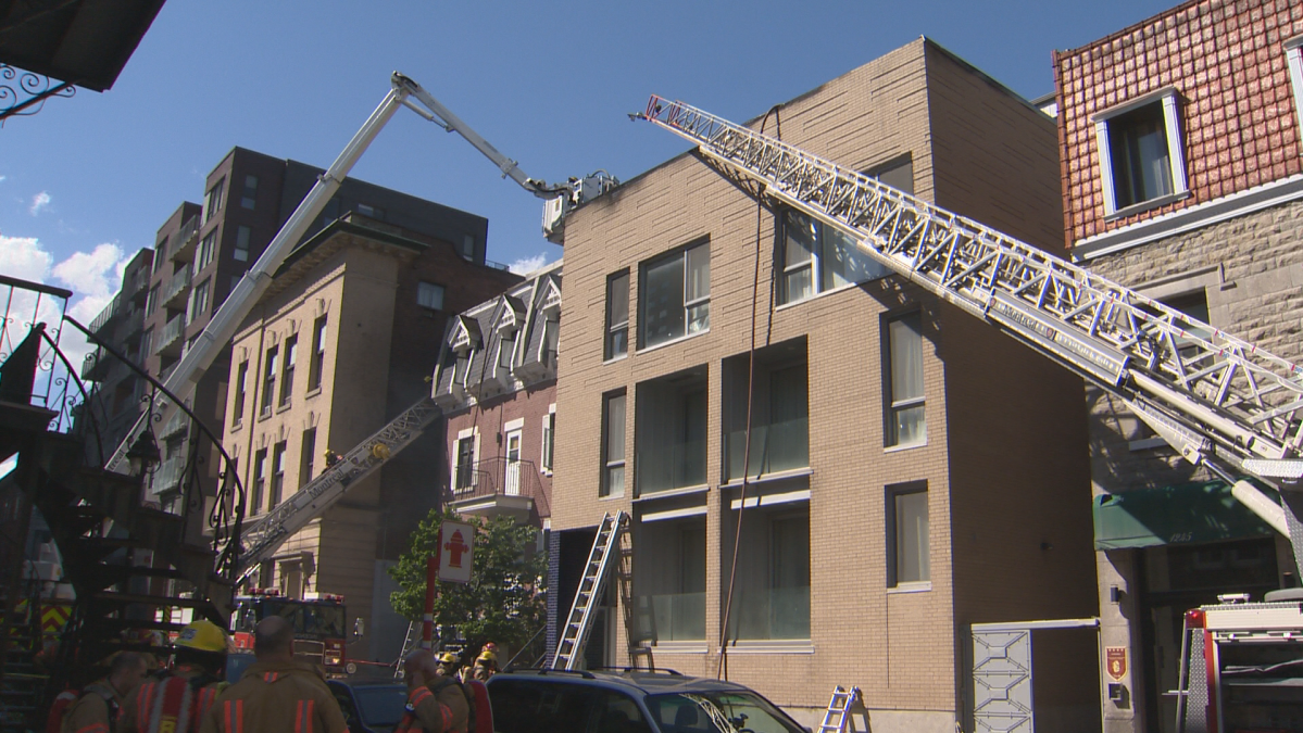 About 100 firefighters have managed to control a blaze in an apartment building in downtown Montreal. Thursday June 11, 2020.