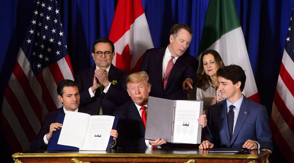 Prime Minister Justin Trudeau, right to left, Foreign Affairs Minister Chrystia Freeland, United States Trade Representative Robert Lighthizer, President of the United States Donald Trump, Mexico's Secretary of Economy Ildefonso Guajardo Villarreal, and Mexican President Enrique Pena Nieto participate in a signing ceremony for the new United States-Mexico-Canada Agreement in Buenos Aires, Argentina, Friday, Nov. 30, 2018.