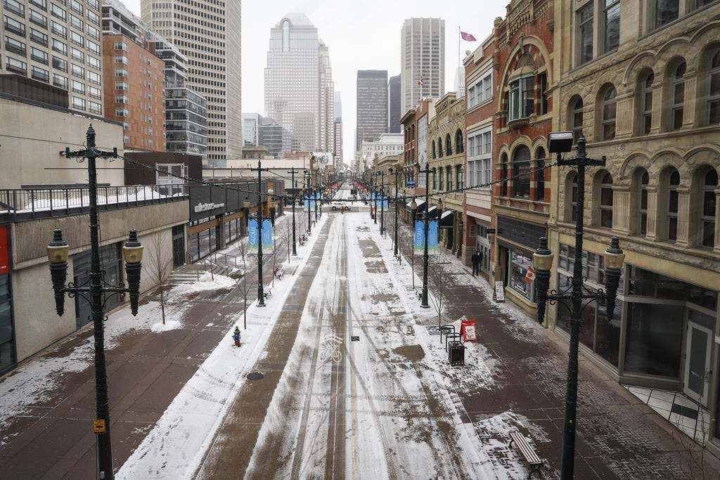 Empty downtown streets in Calgary, Alta., Wednesday, March 18, 2020, amid the COVID-19 pandemic.