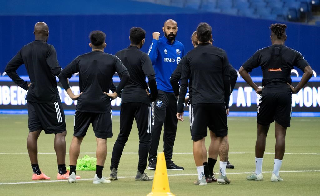 In this March 2020 file photo, players listen to Montreal Impact head coach Thierry Henry during a practice in Montreal.