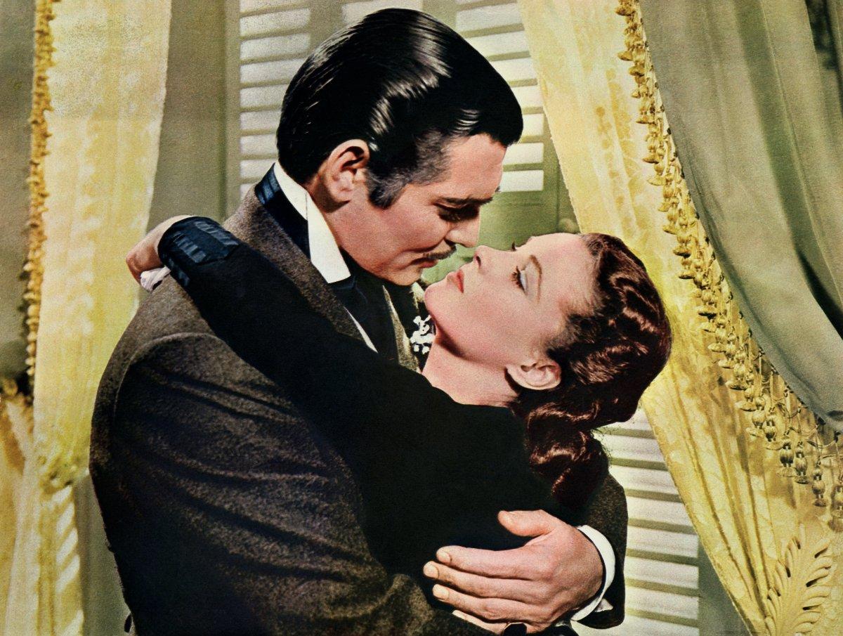 Rhett Butler (Clark Gable) embraces Scarlett O'Hara (Vivien Leigh) in a famous scene from the 1939 film 'Gone with the Wind.'.