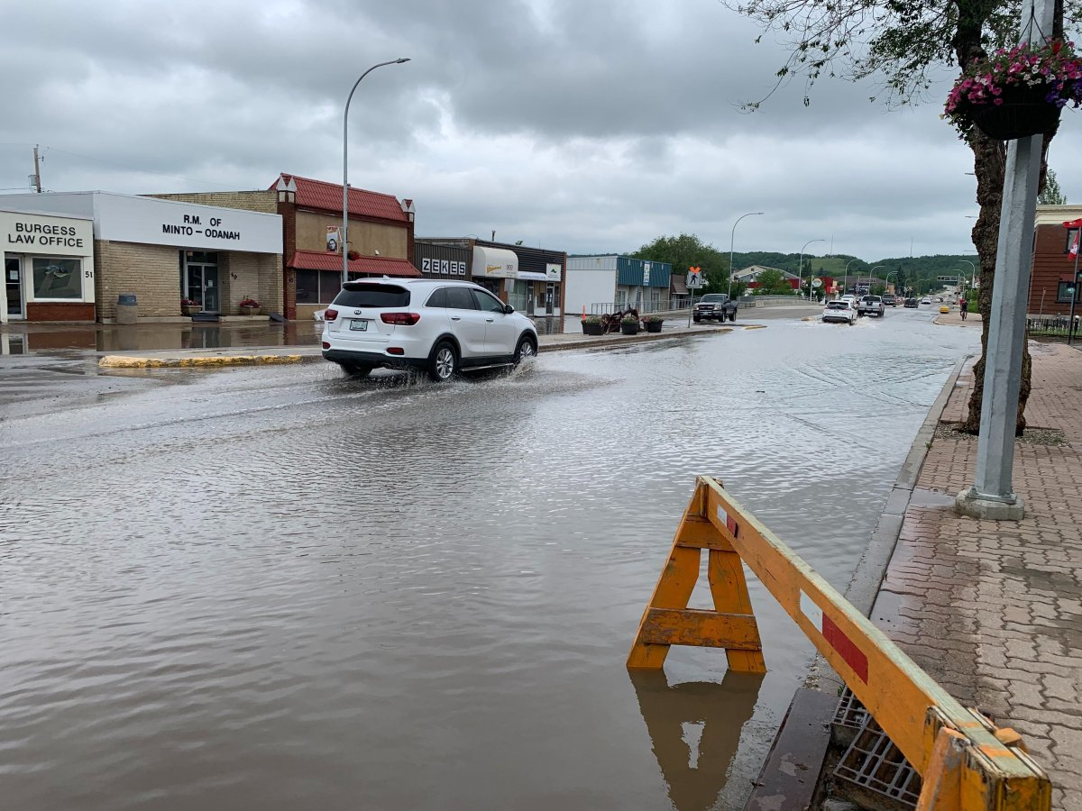 Main Street in Minnedosa was flooded out June 29 after heavy rains.