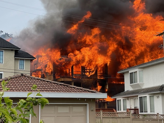Fire engulfs a four-storey condo building at West 62 Avenue and Columbia Street in south Vancouver on June 18, 2020.