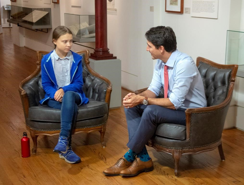 Canadian Prime Minister and Liberal leader Justin Trudeau speaks Swedish environmental activist Greta Thunberg in Montreal on September 27, 2019. Teenage climate activist Greta Thunberg is urging developing island nations to use the upcoming United Nations Security Council election to push Canada and Norway to step up their games on climate change. THE CANADIAN PRESS/Ryan Remiorz.