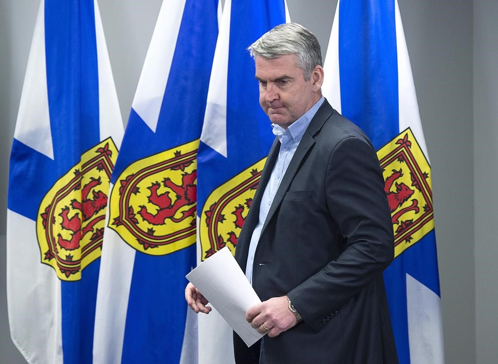 Premier Stephen McNeil arrives at a news conference in Halifax on Sunday, March 15, 2020.