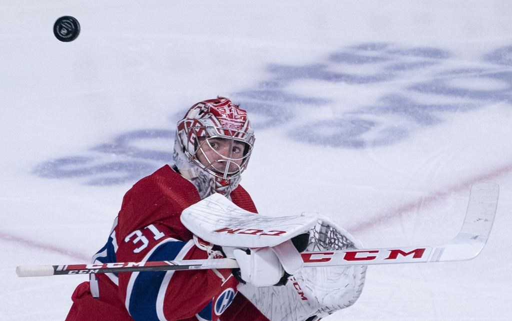 Montreal Canadiens goaltender Carey Price defects a shot as they face the New York Rangers during second-period NHL hockey action in Montreal on Thursday, Feb. 27, 2020.