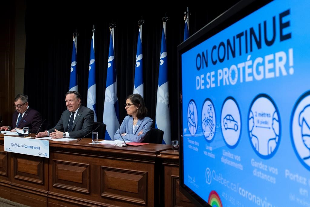 Quebec Premier Francois Legault, centre, Horacio Arruda, Quebec director of National Public Health, left, and Quebec Health Minister Danielle McCann during a news conference on the COVID-19 pandemic, Tuesday, June 9, 2020 at the legislature in Quebec City. THE CANADIAN PRESS/Jacques Boissinot.