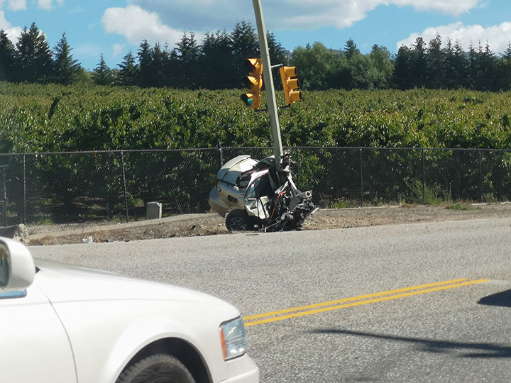 A photo showing half of a car after it hit a light pole in Kelowna on Thursday afternoon.