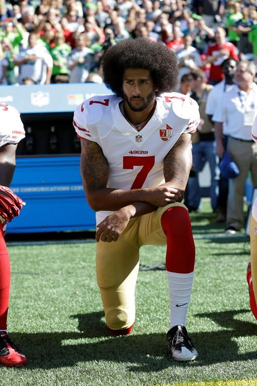 FILE - In this Sept. 25, 2016, file photo, San Francisco 49ers' Colin Kaepernick kneels during the national anthem before an NFL football game against the Seattle Seahawks, Sunday, Sept. 25, 2016, in Seattle. When Colin Kaepernick took a knee during the national anthem to take a stand against police brutality, racial injustice and social inequality, he was vilified by people who considered it an offense against the country, the flag and the military. Nearly four years later, it seems more people are starting to side with Kaepernick's peaceful protest and now are calling out those who don't understand the intent behind his action. (.