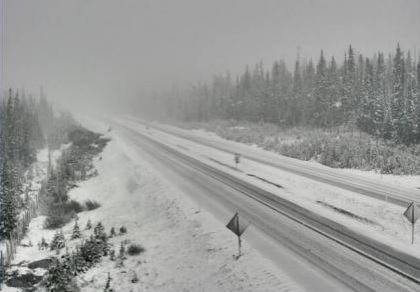 Highway Cam footage shows snow falling on Highway 97C near the Pennask Summit at 7:30 Sunday morning.