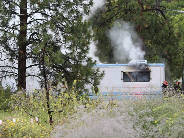 Smoke rises from a motorhome fire along Pine Ridge Drive in Oliver, B.C., on Tuesday morning.