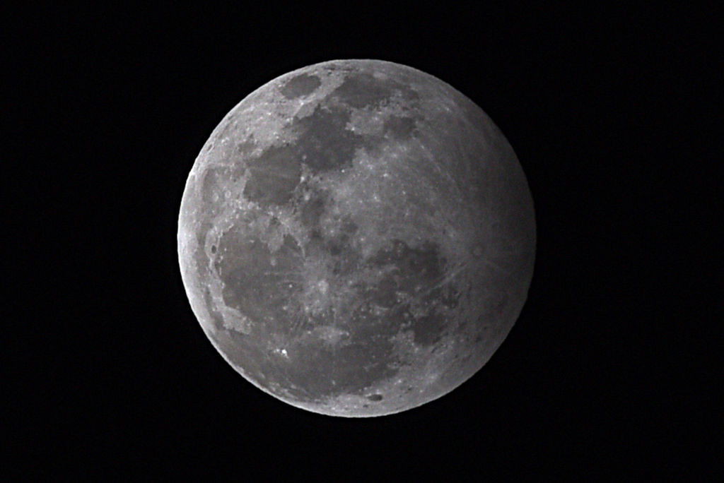 This file photo shows a view of the moon during a penumbral lunar eclipse, on January 10, 2020 in New Delhi, India.