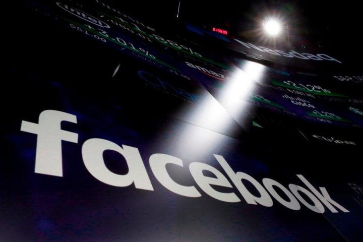 In this March 29, 2018, file photo, the logo for Facebook appears on screens at the Nasdaq MarketSite in New York's Times Square. Lululemon Athletica Inc., Mountain Equipment Co-op and Arc'teryx are joining a growing list of top international brands vowing not to advertise on Facebook Inc. in July because of hateful content the social media giant allowed to spread.
