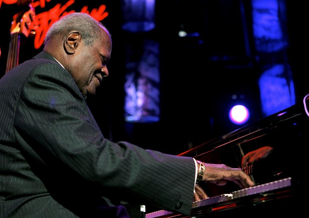 Canadian jazz legend Oscar Peterson performs on the Stravinski hall stage during the 39th Montreux Jazz Festival in Montreux, Switzerland, Saturday, July 16, 2005.