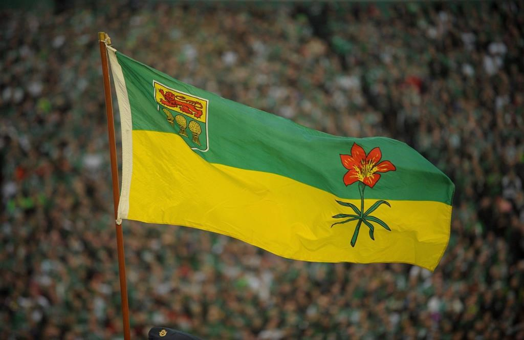 The Saskatchewan flag blows in the wind before the final Saskatchewan Roughriders game at Mosaic Stadium in Regina on Saturday, Oct. 29, 2016. The Saskatchewan government is extending services to youth who otherwise would be aging out of the foster care system. THE CANADIAN PRESS/Mark Taylor.