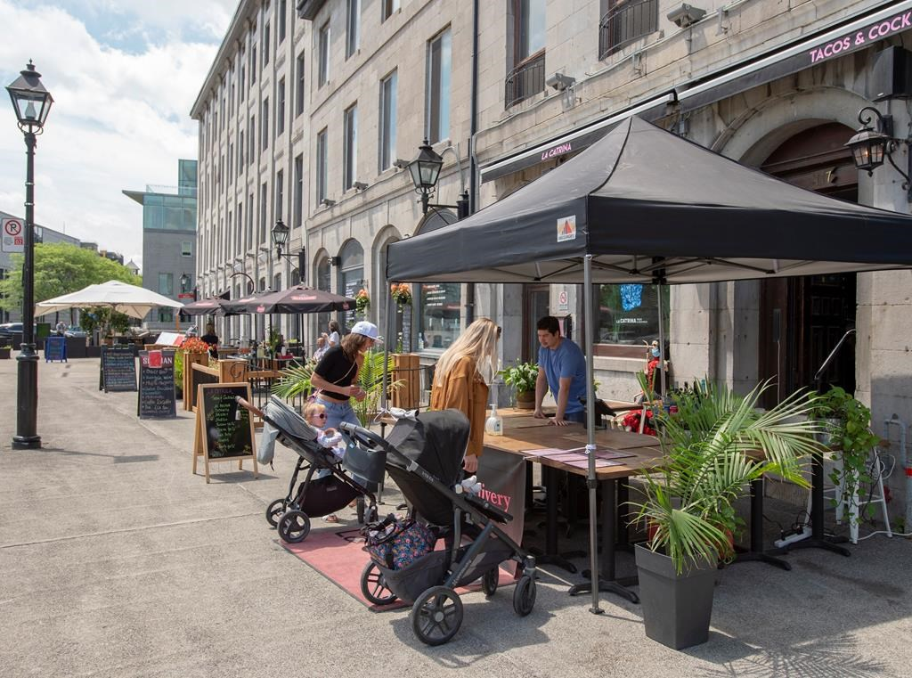 Restaurants and bars offer takeout food and drinks in Old Montreal on Thursday, June 4, 2020.