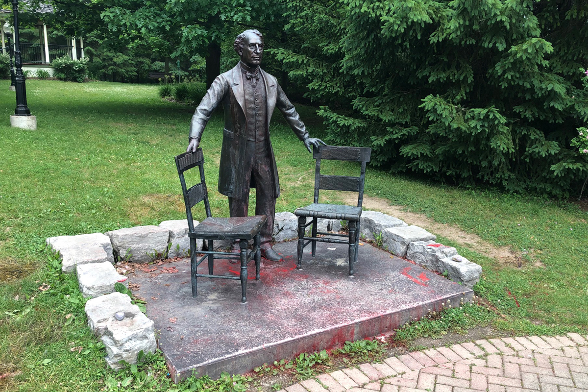 Red paint could still be seen Monday morning on the statue of Sir John A. Macdonald in Baden, Ont.