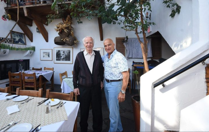 Theo Theodosakis (left) and new owner Greg Condon (right) at Theo's Restaurant in Penticton, B.C.