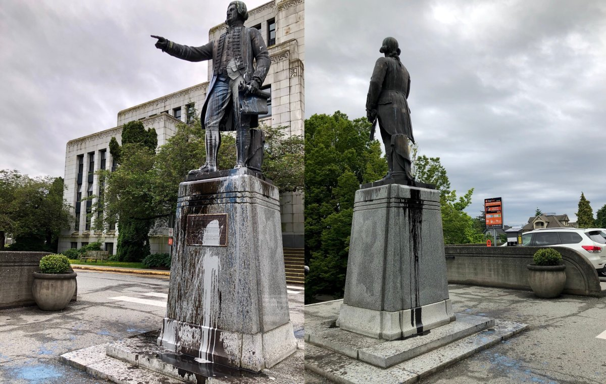 Paint splatters seen on a statue of George Vancouver in front of Vancouver City Hall on June 11, 2020.