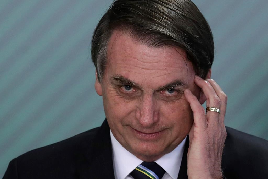 FILE - In this April 9, 2019 file photo, Brazil's President Jair Bolsonaro speaks during a swearing-in ceremony at the Planalto Presidential Palace, in Brasilia, Brazil. Bolsonaro's latest education minister offered his resignation Tuesday, June 30, 2020, just days after his appointment, creating a new headache for the embattled leader as he struggles to start a new chapter at the ministry and shore up flagging support.