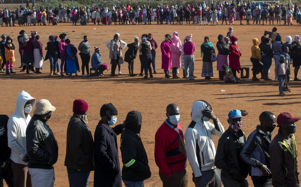 FILE — In this May 20, 2020 file photo, people affected by the coronavirus economic downturn line up to receive food parcels in Pretoria, South Africa, South Africa's economy is expected to decline by 7.2% this year, its worst performance in 90 years, as the coronavirus pandemic takes a toll on sub-Saharan Africa's most developed country.