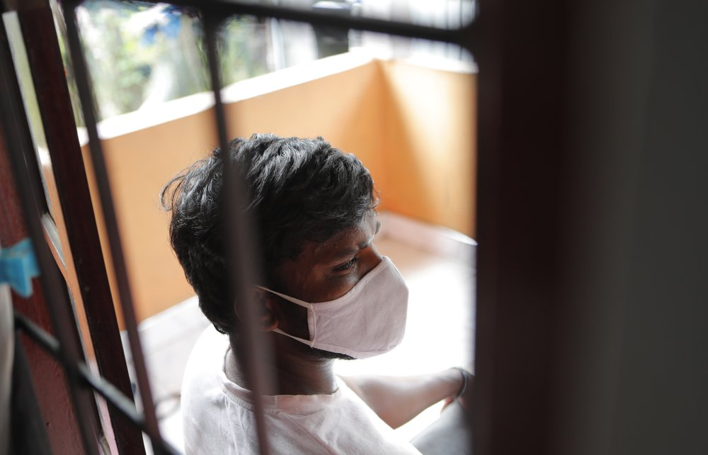 """Sri Lankan auto rickshaw driver Prasad Dinesh, linked by Sri Lankan officials to nearly half the country's more than 2,600 coronavirus cases, sits in his house in Ja-Ela, Sri Lanka, Wednesday, July 1, 2020. For months he's been anonymous, but now Dinesh is trying to clear his name and shed some of the stigma of a heroin addiction at the root of his ordeal. Referring to him only as """"Patient 206,"""" government officials lambasted Dinesh on TV and social media, blaming him for at least three clusters of cases, including about 900 navy sailors who were infected after an operation in Ja-Ela, a small town about 19 kilometers (12 miles) north of the capital, Colombo. Dinesh, however, says his drug addiction, which is considered a crime in Sri Lanka, makes him a convenient scapegoat."""