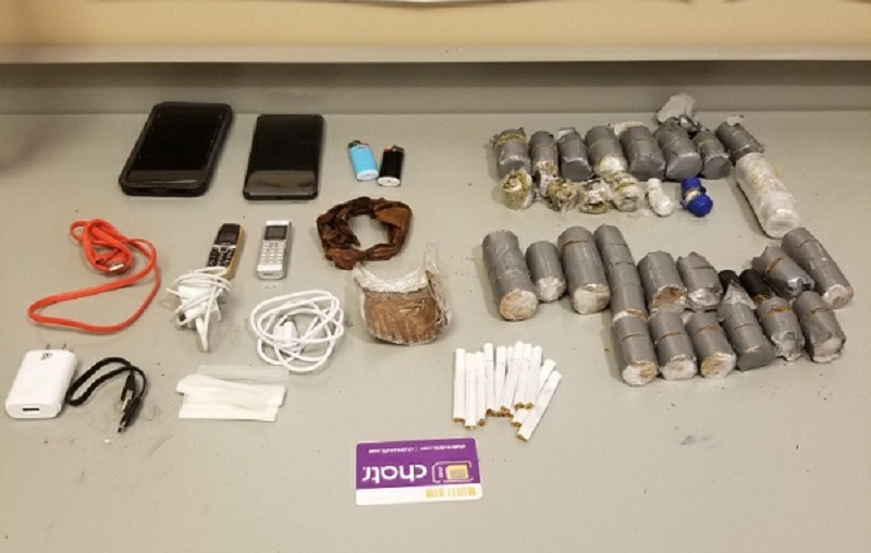 Kingston police say a Mississaugua man was caught trying to drop contraband over the walls of Collins Bay Institution.