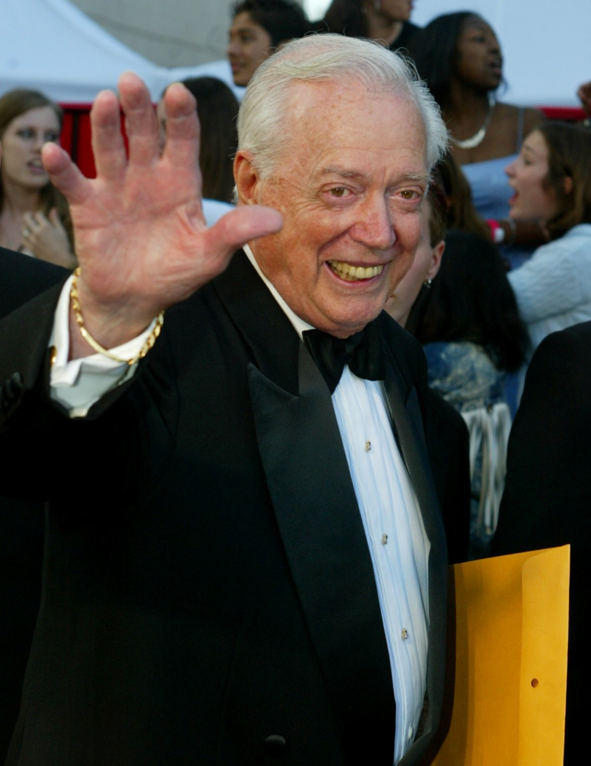 """FILE PHOTO: Hugh Downs, former host of the ABC news program """"20/20"""" poses as he arrives for the ABC television networks 50th anniversary in Hollywood, U.S., March 16, 2003."""