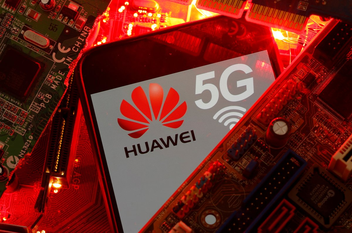 FILE PHOTO: A smartphone with the Huawei and 5G network logo is seen on a PC motherboard in this illustration picture taken January 29, 2020. REUTERS/Dado Ruvic/Illustration/File Photo.